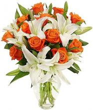 Vase of Orange Roses and White Oriental Lilies
