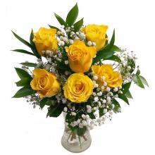 6 yellow roses in a glass vase