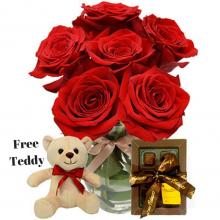 Red Roses Vase , Chocolates and a Free  Teddy Bear